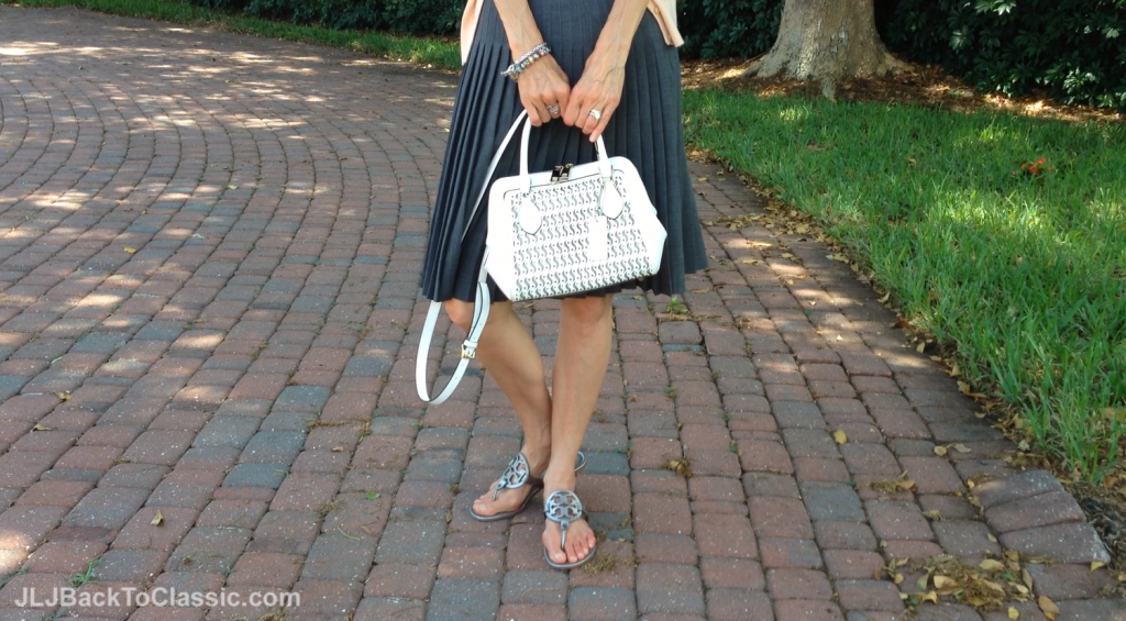 Ann-Taylor-Grey-Pleated-Skirt-Tory-Burch-Sandals-And-Cromia-Bag