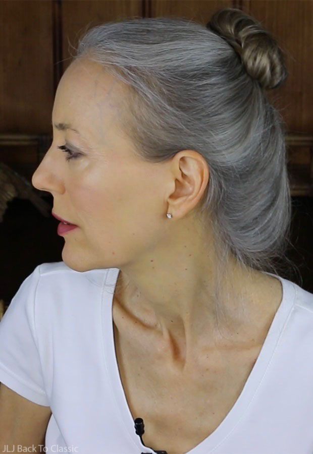 classic-beauty-over-50-long-grey-hair-in-loose-bun-janis-lyn-johnson