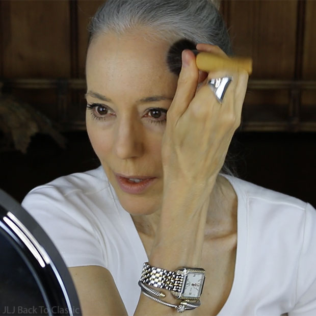 applying-rms-beauty-lip-and-cheek-color- forehead-classic-green-beauty-over-50