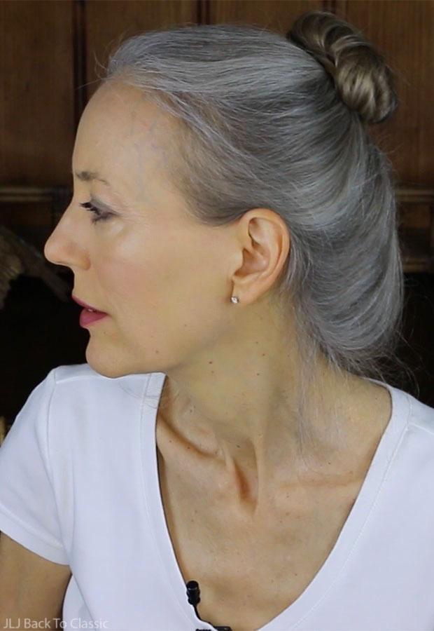 classic-beauty-over-50-long-grey-hair-in-loose-bun-janis-lyn-johnson
