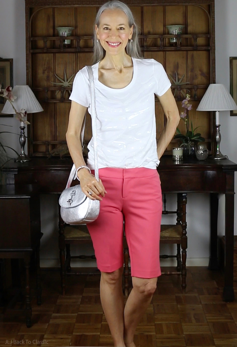 classic-fashion-style-over-40-slim-coral-shorts-white-tee-silver-crossbody
