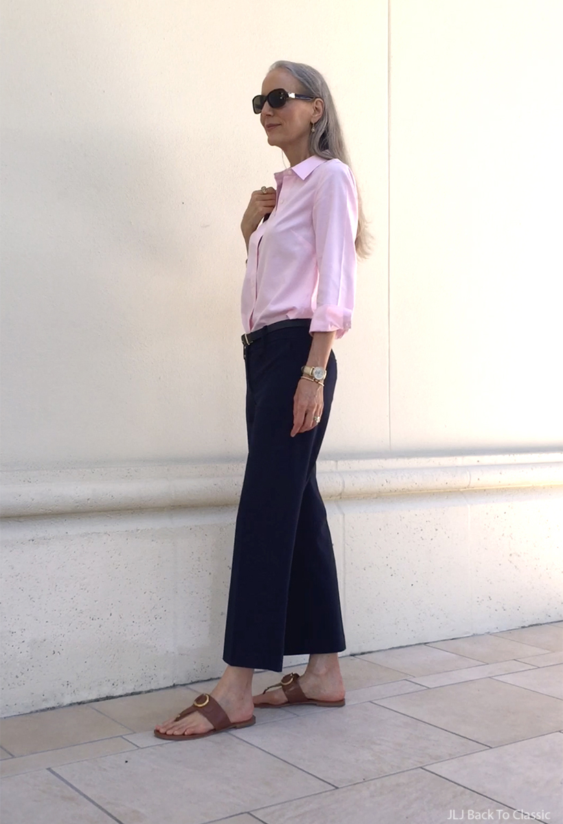 classic-fashion-cropped-navy-wide-leg-pants-pink-button-up-cognac-sandals